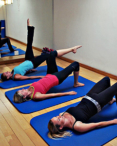Studio2Pilates instructors doing shoulder bridges with modifications