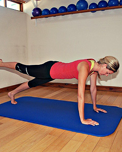 Pilates instructor doing front support