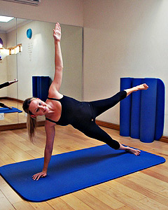 Pilates instructor doing the starfish