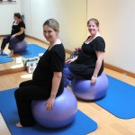 Pregnant Lades sitting on Pilates balls
