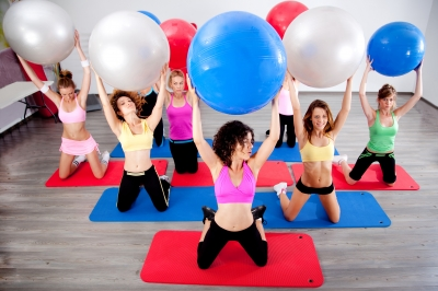 A group of ladies doing Pilates ball exercises