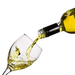 Wine bottle pouring into glass