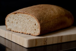 Loaf of bread on cutting board - many of us consume our grains in this form