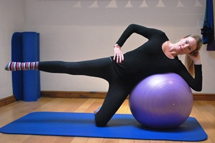 Side lying exercise on ball